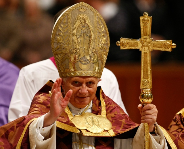 Pope Benedict XVI delivers his blessing during a Vespers Mass in St. Peter's Basilica at the Vatican, Saturday, Nov. 28, 2009. (AP Photo/Pier Paolo Cito)