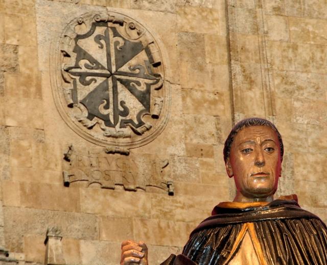 dominic statue w logo