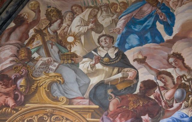 An interesting but complex allegorical 18th-century fresco adorns the choir of the Dominican church of San Esteban in Salamanca. In this detail, we see a personification of the Mother Church carrying the Eucharist, the Cross, the Gospel of Matthew, and the book of the Elect. She is robed, as usual, in pontifical vesture, and crowned with the papal tiara. Next to her is St Thomas Aquinas, the Universal Doctor of the Church.